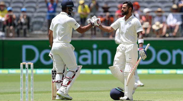 Kohli gets his half-century as India make Oz toil hard