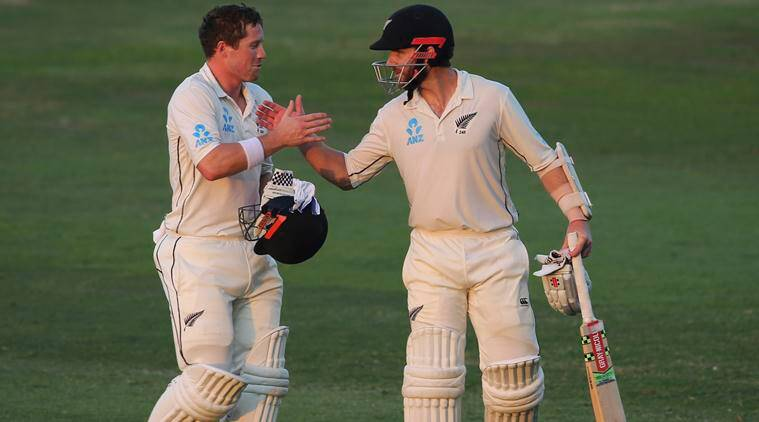 Henry Nicholls and Kane Williamson shake hands