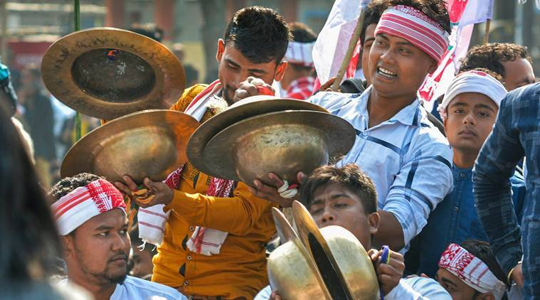 Guwahati: People play traditional cymbals while taking part in All Assam Students' Union (AASU)'s mass agitation programme against Citizenship (Amendment) Bill, 2016 in Guwahati, Wednesday. (PTI Photo)