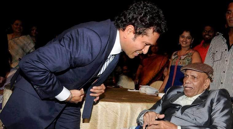 In this May 24, 2017 file photo cricket coach Ramakant Achrekar is seen with cricket legend Sachin Tendulkar during the premiere of his biopic 'Sachin: A Billion Dreams' in Mumbai.