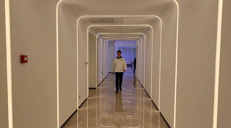 At Alibaba's futuristic hotel, robots deliver towels and mix cocktails