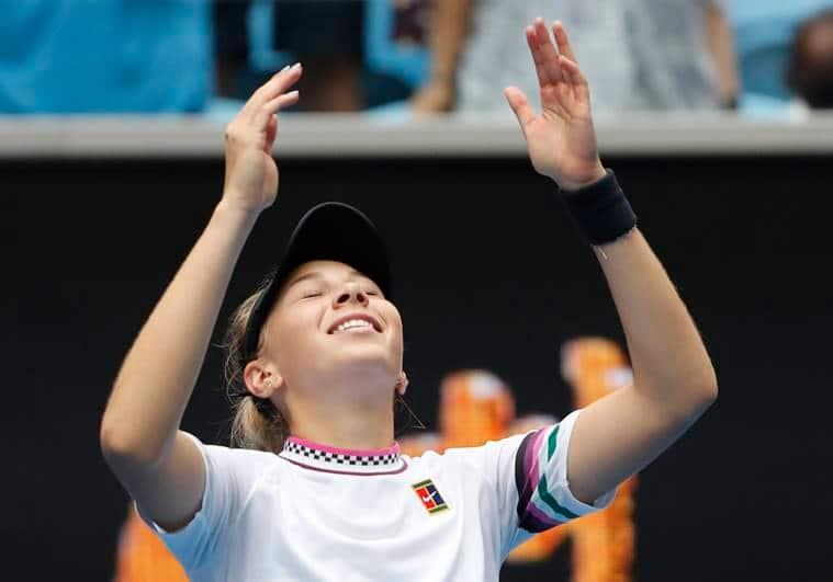 Amanda Anisimova of the U.S. celebrates winning the match against Belarus' Aryna Sabalenka.