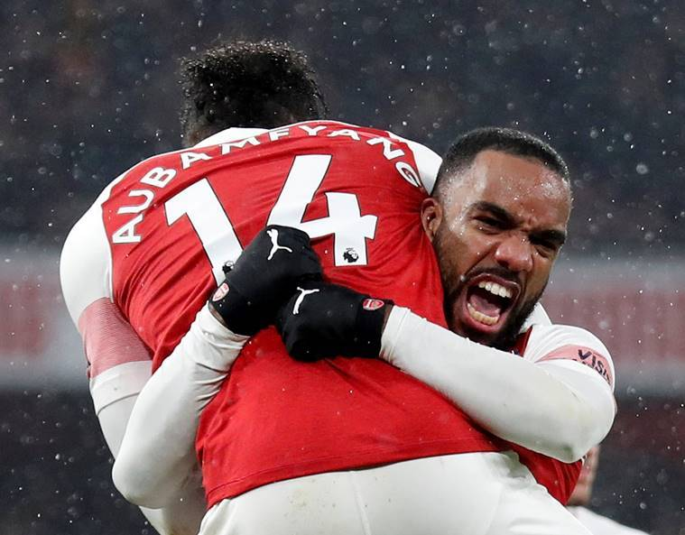 Arsenal's Pierre-Emerick Aubameyang celebrates scoring their first goal with Alexandre Lacazette