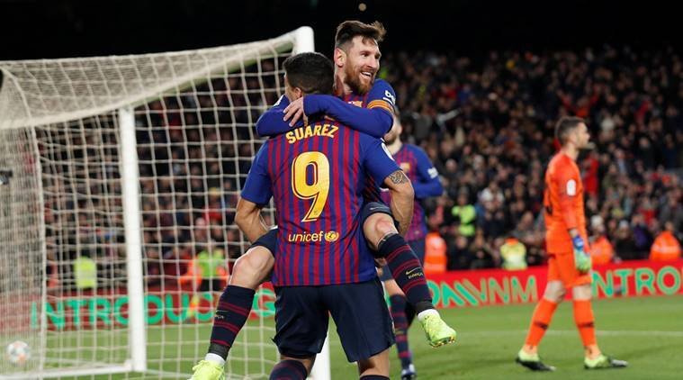 Barcelona's Lionel Messi celebrates scoring their sixth goal against Sevilla with Luis Suarez