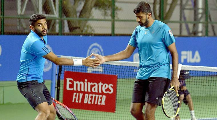 Indian pair Rohan Bopanna (R) and Divij Sharan celebrate after defeating Radu Albot-Malek Jaziri pair, in the Men's double of the first round on Day two during the Tata Open Maharashtra at Mhalunge Balewadi Tennis Stadium