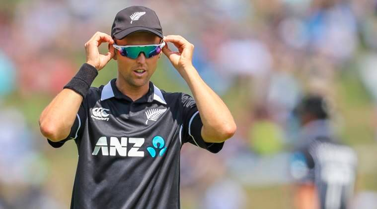 New Zealand's Trent Boult adjusts his sunglasses in the field during their fourth one day international cricket match against India at Seddon Park in Hamilton, New Zealand