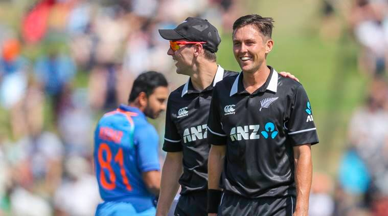 New Zealand's Trent Boult, right, is congratulated on taking an Indian wicket during their one day international cricket match at Seddon Park in Hamilton, New Zealand