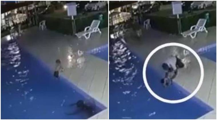 brazil, boy almost drowns in poor, child swimming pool drowns, security guard saves drowning child, child saved viral video,