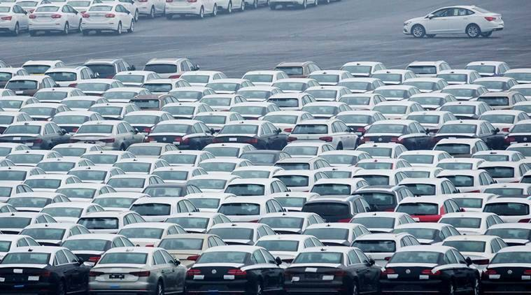 A file photo of newly manufactured cars are seen at the automobile terminal in the port of Dalian