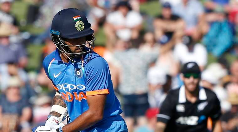 India's Shikhar Dhawan looks at his stumps after almost playing on during a one day international cricket match between New Zealand and India in Napier, New Zealand
