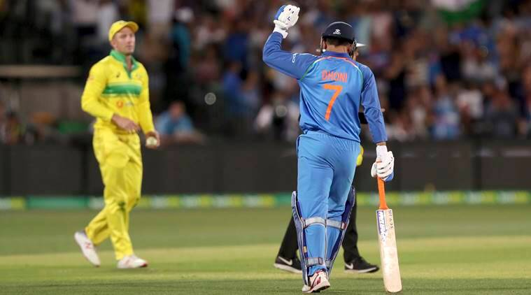 India's M.S. Dhoni celebrates hitting the winning runs against Australia during their one day international cricket match in Adelaide, Australia