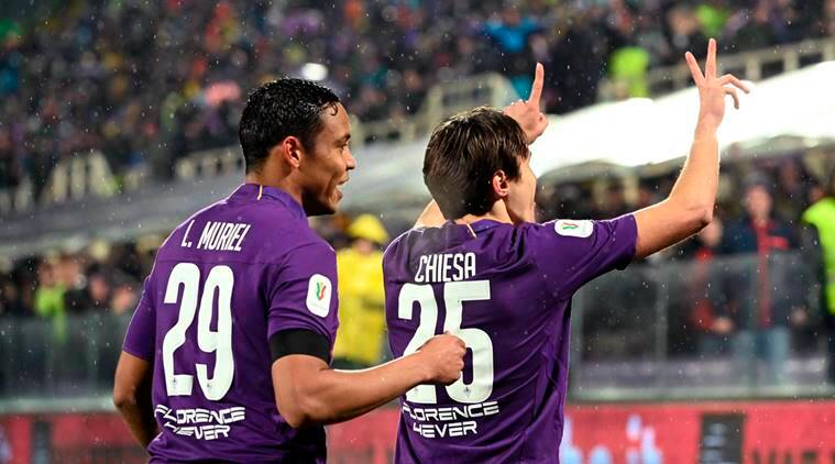Federico Chiesa celebrates with his teammate Luis Muriel after scoring during the Italian Cup quarterfinal soccer match between Fiorentina and Roma, at the Artemio Franchi stadium in Florence, Italy