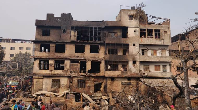 A timber godown and a few huts, housing combustible materials, were gutted in the fire. (Express photo/Renuka Puri)