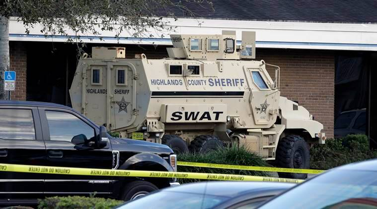 'I have shot five people': 21-year-old held in massacre at Florida Bank