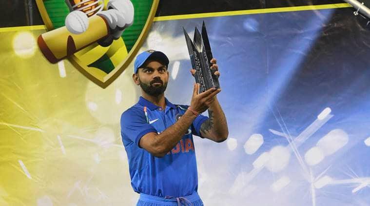 India's Virat Kohli poses with the Border–Gavaskar Trophy during their one day international cricket match against Australia in Melbourne, Australia