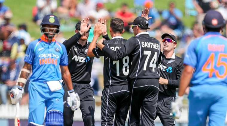 New Zealand celebrates the wicket of India's Shikhar Dhawan, left, during their fourth one day international cricket match at Seddon Park in Hamilton, New Zealand