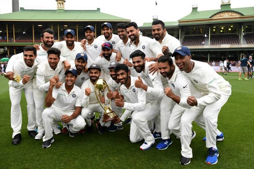 The Indian team poses for a photograph with the Border-Gavaskar Trophy as they celebrate a 2-1 series victory over Australia following play being abandoned in the fourth test match between Australia and India at the SCG in Sydney, Australia