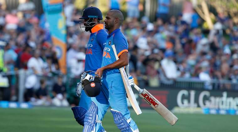 India's Virat Kohli, left, and teammate Shikhar Darma leave the pitch for a short time during a one day international between New Zealand and India in Napier, New Zealand