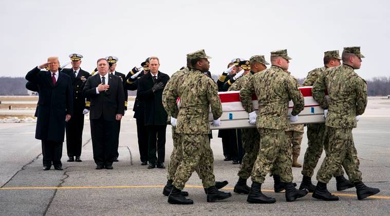 From left: President Donald Trump, Secretary of State Mike Pompeo and acting Secretary of Defense Patrick Shanahan look on as military servicemen carry the remains of Scott A. Wirtz, one of four Americans killed in a suicide bombing in Syria, at Dover Air Force Base in Delaware, on Jan. 19, 2019.