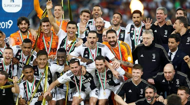 Juventus players celebrate winning the Italian Super Cup against AC Milan