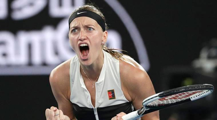 Petra Kvitova of the Czech Republic celebrates after winning the first set against United States' Danielle Collins during their semifinal at the Australian Open tennis championships in Melbourne, Australia