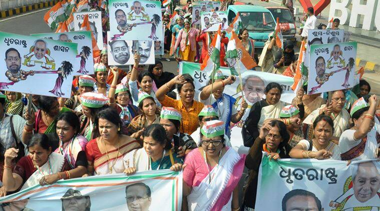 Mahila Congress members during a protest rally demanding expulsion of state's Agriculture Minister Pradeep Maharathy. (PTI)
