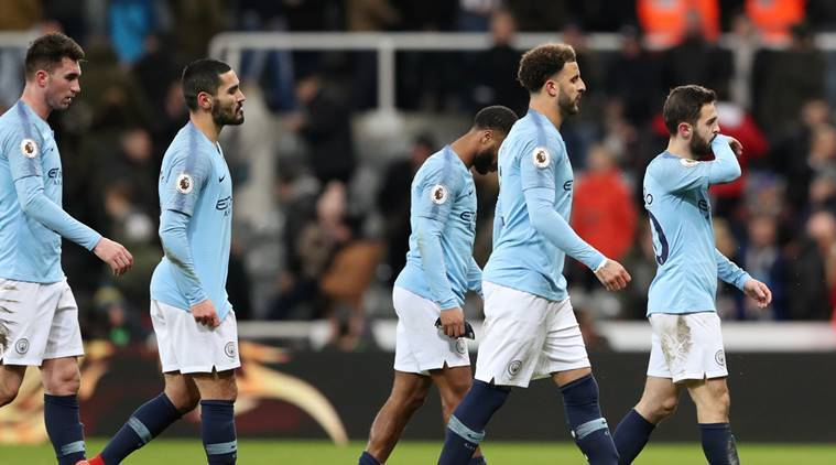 Manchester City players look dejected after the match against Newcastle United