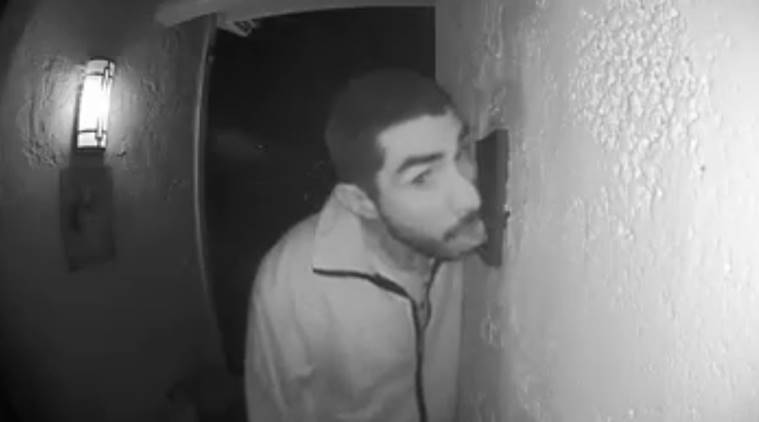 Man caught on camera licking the doorbell of a house