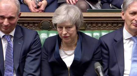 Theresa May's wins no-confidence vote but faces battle to keep control of Brexit