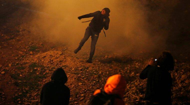 US agents fire tear gas at 'violent mob' near Mexico border
