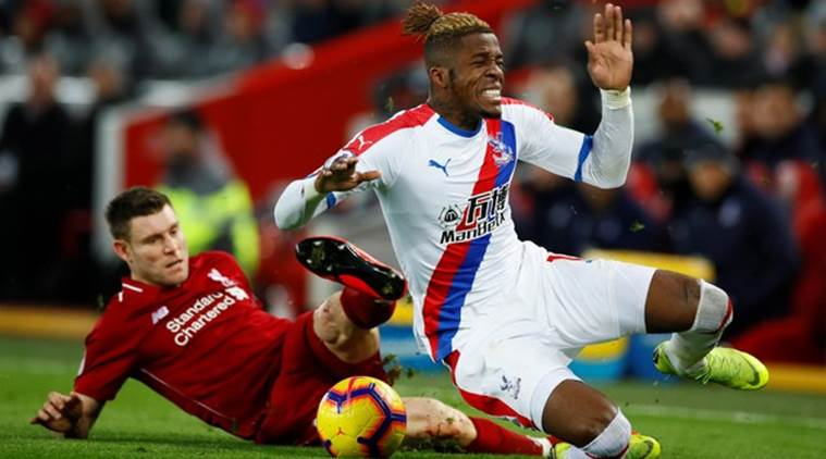 James Milner tackles Wilfried Zaha