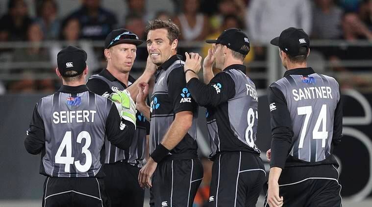 New Zealand's captain Tim Southee, center, is congratulated on taking a wicket of Sri Lanka's Kusal Mendis during their twenty/20 cricket international at Eden Park in Auckland, New Zealand