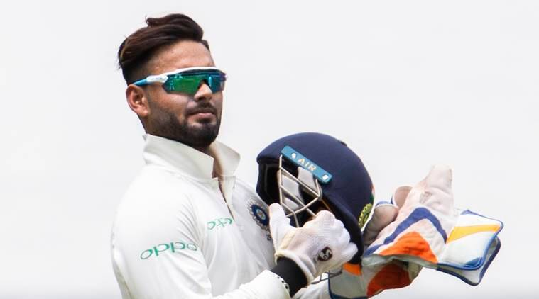 India's wicketkeeper Rishabh Pant holds his helmet during play on day three of the third cricket test between India and Australia in Melbourne, Australia