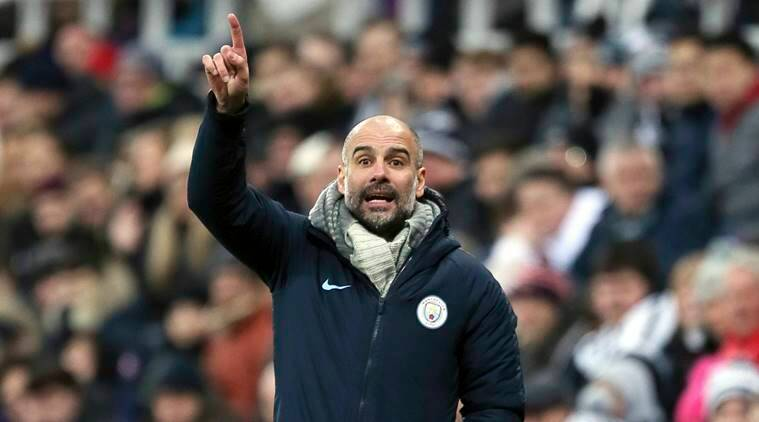 Manchester City manager Pep Guardiola gestures on the sideline during a English Premier League soccer match against Newcastle United at St James' Park in Newcastle, England