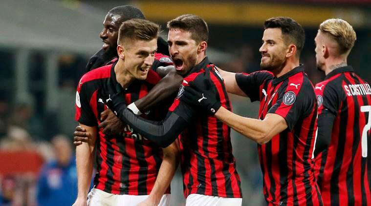 AC Milan's Krzysztof Piatek, second from left, celebrates with his teammates after scoring his side's second goal during an Italian Cup quarter-final soccer match between AC Milan and Napoli at the San Siro stadium, in Milan, Italy
