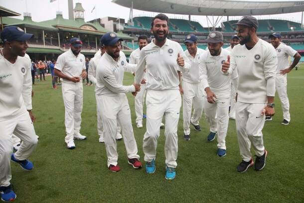 India's Virat Kohli, right, encourages Cheteshwar Pujara, center, as the team dance as they celebrate their series win over Australia after play was called off on day 5 of their cricket test match in Sydney