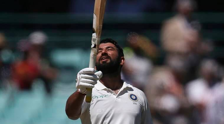 Cheteshwar Pujara celebrates making 150 runs against Australia on day 2 during their cricket test match in Sydney