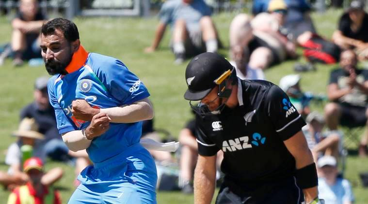 India's Mohammed Shami, left, bowls out Martin Guptil during a one day international cricket match between New Zealand and India in Napier, New Zealand