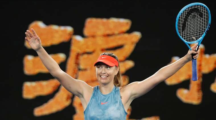 Russia's Maria Sharapova celebrates after winning the match against Denmark's Caroline Wozniacki at Australian Open