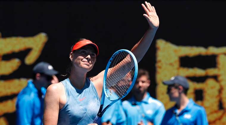 Russia's Maria Sharapova waves to spectators at her match against Britain's Harriet Dart at the Australian Open