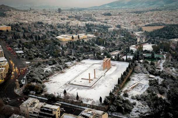 Snow coats ancient monuments in Athens amid record cold spell
