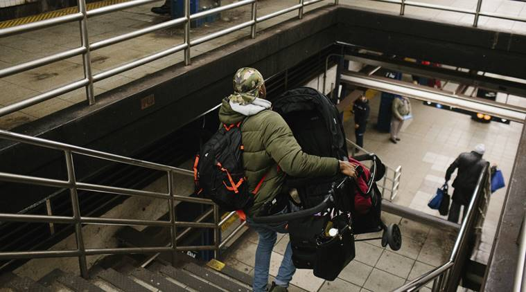 Young mother, hauling child and stroller down subway steps, dies