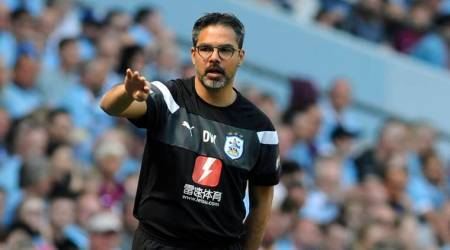 Huddersfield manager David Wagner gives directions to his team during their English Premier League soccer match against Manchester City at Etihad stadium in Manchester, England