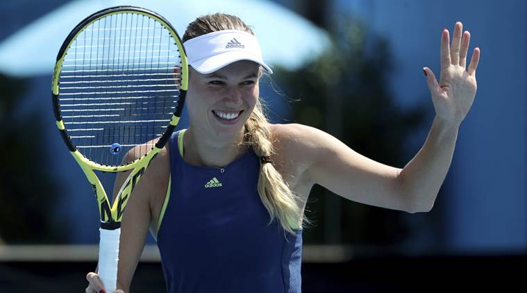 Champion Wozniacki through to second round with comfortable win