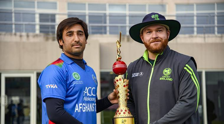 Ireland's captain Paul Stirling and Afghanistan counterpart Asghar Afghan reveal the trophy for the upcoming Afghanistan-Ireland ICC cricket series, in Dehradun
