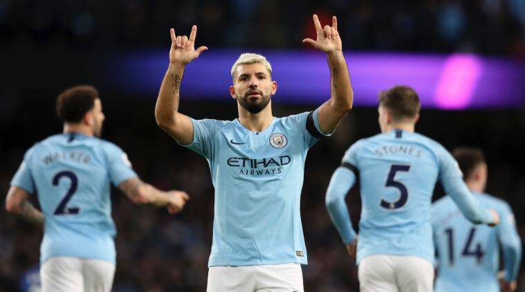 Manchester City's Sergio Aguero celebrates after scoring his side's fifth goal during the English Premier League soccer match between Manchester City and Chelsea at Etihad stadium in Manchester, England