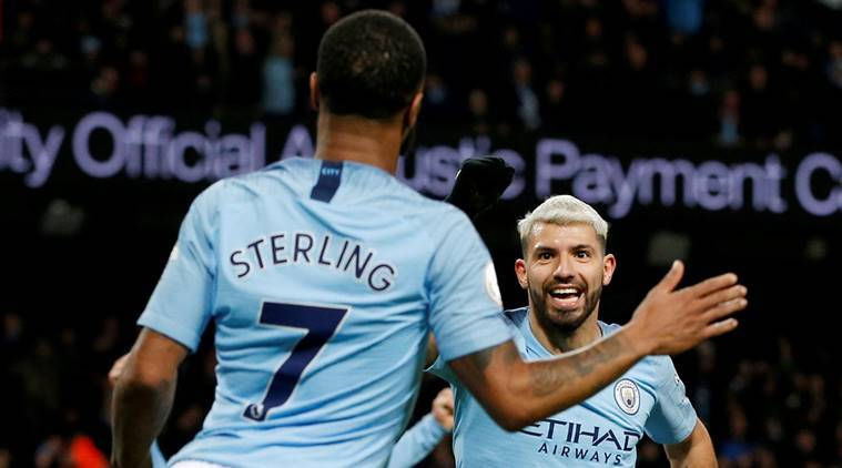 Manchester City's Sergio Aguero celebrates scoring their third goal against Arsenal to complete his hat-trick with Raheem Sterling