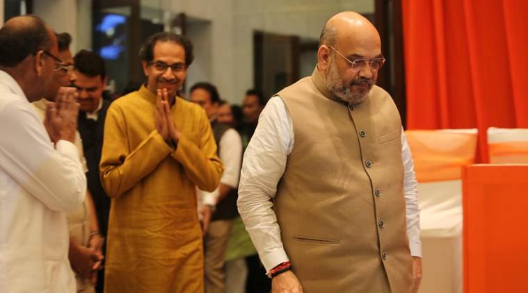 Uddhav Thackeray and Amit Shah arrive to address the media on Friday. (Express photo/Prashant Nadkar)