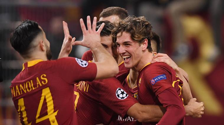 AS Roma's Nicolo Zaniolo celebrates scoring their second goal with team mates