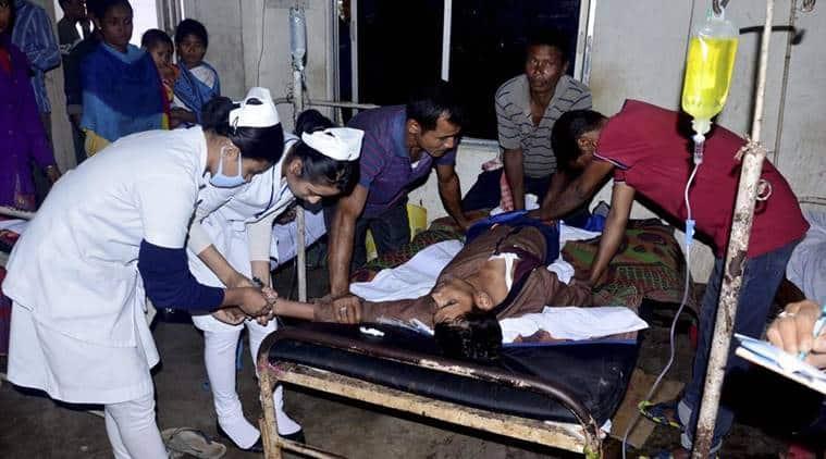 assam liquor death, assam hooch tragedy, assam hooch death, assam hooch death inquiry, Sarbananda Sonowal, Halmira Tea Estate, Assam CM on tragedy, sarbananda sonowal, assam poisonous liquor deaths, assam liquor death toll, indian express news